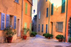 Narrow Alley in Saint Tropez at Cote D'azur, France by PlusONE