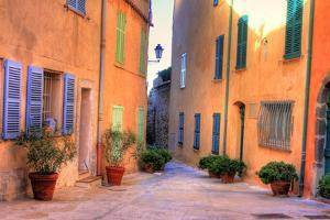 Narrow Alley in Saint Tropez at Cote D'azur, France by PlusONE