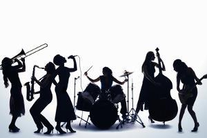 Silhouette of Female Musicians by PM Images