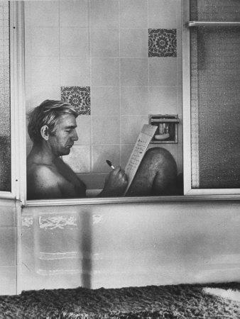 Poet rod mckuen writing song lyrics in his bathtub at home