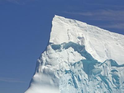 https://imgc.artprintimages.com/img/print/pointy-blue-iceberg-sculpted-by-waves_u-l-pzl4xo0.jpg?p=0