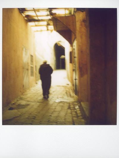 Polaroid Image of Man Walking Along Narrow, Dimly-Lit Street in the Medina, Fez, Morocco-Lee Frost-Photographic Print