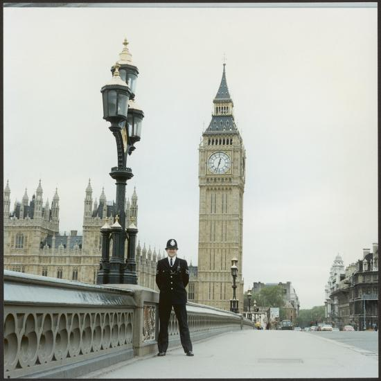 Police Officer on Duty on Westminster Bridge by Big Ben, London. Metropolitan Police--Photographic Print