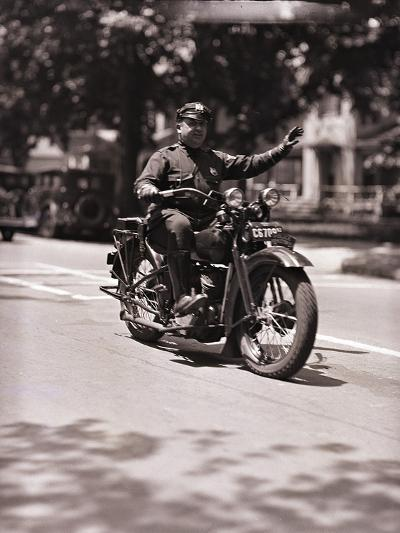 Police Officer on Motorcycle-Philip Gendreau-Photographic Print
