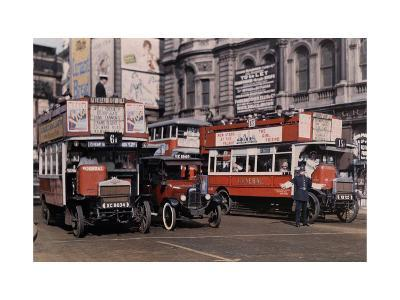 Policeman Directs Buses in the Intersection of Trafalgar Square-Clifton R^ Adams-Photographic Print