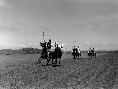 Polo Game in Progress at the Canlubang Sugarcane Plantation-Carl Mydans-Photographic Print