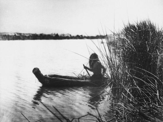 Pomo Indian Poling His Boat Made of Tule Rushes Through Shallows of Clear Lake, Northen California-Edward S^ Curtis-Photographic Print