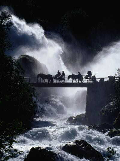 Pony Carts Crossing Bridge Over Waterfall and Rapids, Briksdal, Norway-Craig Pershouse-Photographic Print
