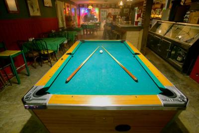 Pool table lit by electric lights in a restaurant and bar in Shoshone, CA near Death Valley Nati...
