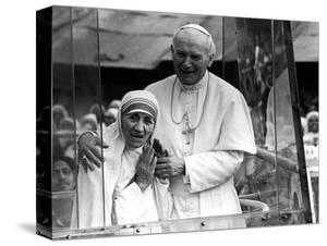 Pope John Paul II Holds His Arm Around Mother Teresa