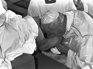 Pope John Paul II Kisses the Feet of One of 12 Mentally Retarded Italians