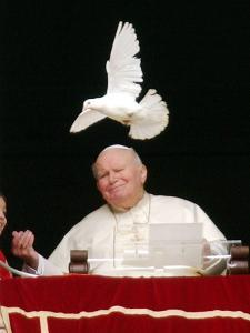 Pope John Paul II Looks at a White Dove After the Angelus Prayer in St. Peter's Square, at Vatican