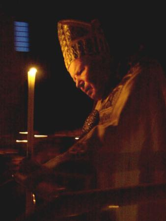 Pope John Paul II Prays Before a Candle at the Beginning of an Holy Easter Vigil Mass