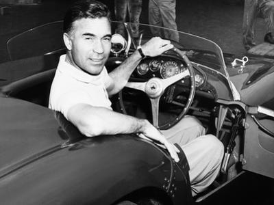 Porfirio Rubirosa at the Wheel of His Italian Race Car, a $17,000 Ferrari Mondial