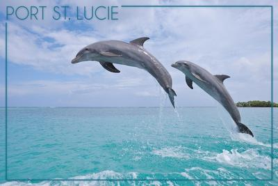 https://imgc.artprintimages.com/img/print/port-st-lucie-florida-dolphins-jumping_u-l-q1gqelb0.jpg?p=0