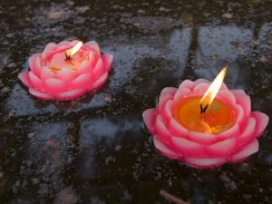 Candle Floating in Dafo Temple, Leshan, Sichuan, China by Porteous Rod
