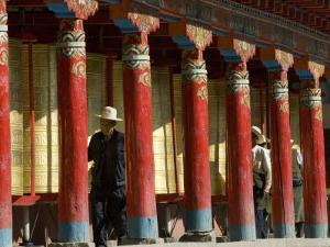 Old Men Turning Prayer Wheels, Tagong Temple, Tagong, Sichuan, China by Porteous Rod
