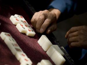 Playing Mahjong, Dali, Yunnan, China by Porteous Rod
