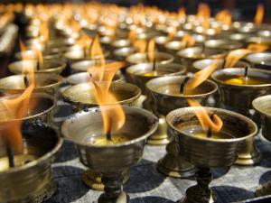 Prayer Candles, Nanwu Temple, Kangding, Sichuan, China by Porteous Rod