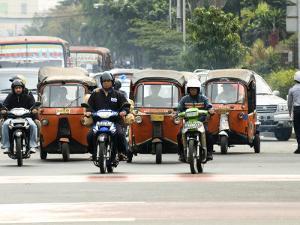 Traffic Including Tuk-Tuk or Bajaj, Jakarta, Java, Indonesia, Southeast Asia by Porteous Rod
