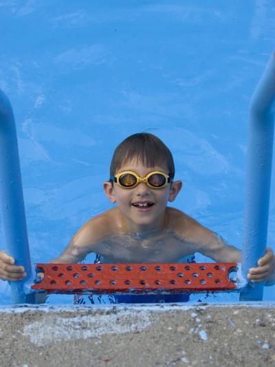 Portrait of 9 Year Old Boy in Swimming Pool, Kiamesha Lake, New York, USA-Paul Sutton-Photographic Print