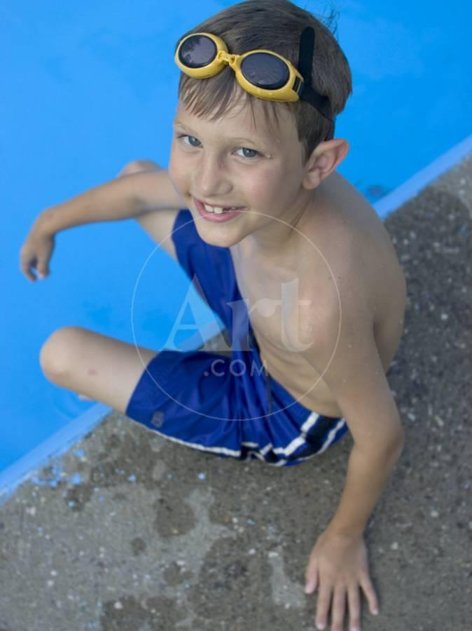 c54336d48f Portrait of 9 Year Old Boy Sitting at the Edge of the Swimming Pool,  Kiamesha Lake, New York, USABy Paul Sutton