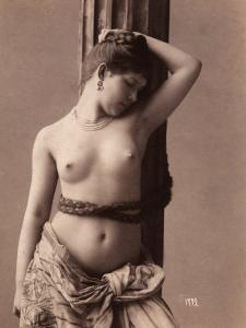 Portrait of a Naked Young Woman with a Braid of Hair Around Her Hips