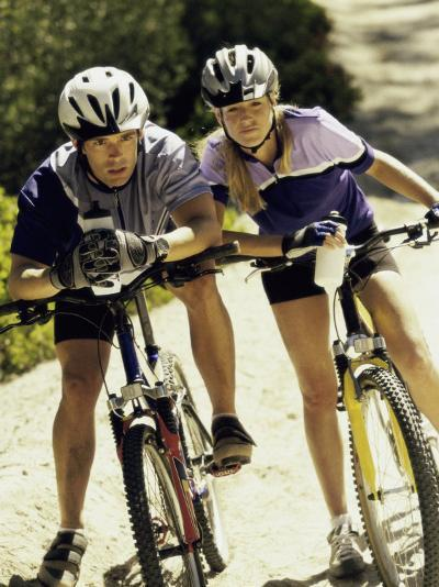 Portrait of a Young Couple Sitting on Bicycles--Photographic Print