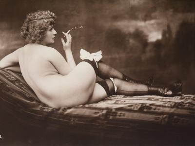 Portrait of a Young Woman Posing Naked, with Her Back Turned, as She Smokes a Cigarette--Photographic Print