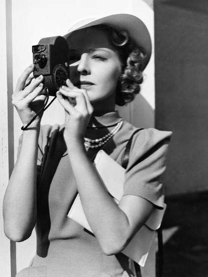 Portrait of a Young Woman Taking a Picture with a Camera-Everett Collection-Photographic Print