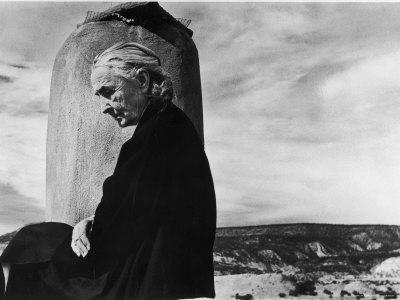 https://imgc.artprintimages.com/img/print/portrait-of-artist-georgia-o-keeffe-sitting-on-the-roof-of-her-ghost-ranch-home_u-l-p43w7k0.jpg?p=0