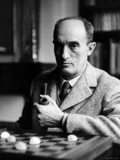 Portrait of Author Pierre Boulle Smoking Pipe, Sitting at Chess Board--Premium Photographic Print