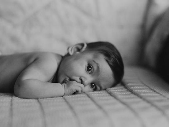 Portrait of Baby Boy (6-11 Months) Lying on Front With Fingers in Mouth-George Marks-Photographic Print