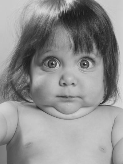 Portrait of Baby Making a Funny Face--Photographic Print