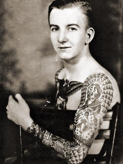 Portrait of Bob Shaw Showing of His Tattooed Sleeves by Bert Grimm, C.1942--Photographic Print