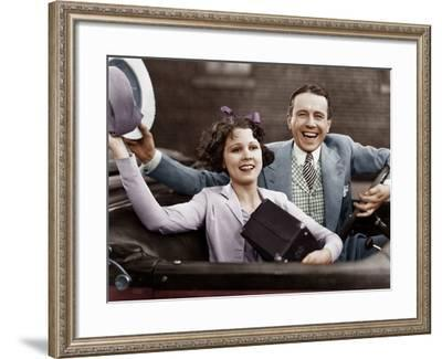 Portrait of Happy Couple Waving in Car--Framed Photo