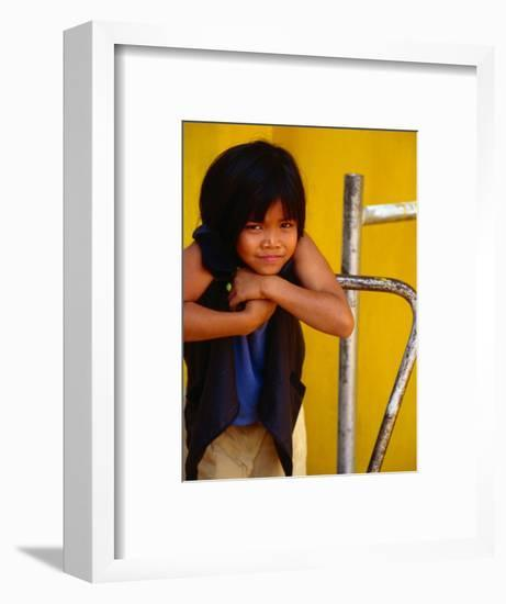 Portrait of Lao Girl at Entrance to Wat St. Muang, Vientiane, Vientiane Prefecture, Laos-Martin Lladó-Framed Photographic Print