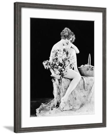 Portrait of Nude Woman Holding Flowers--Framed Photo