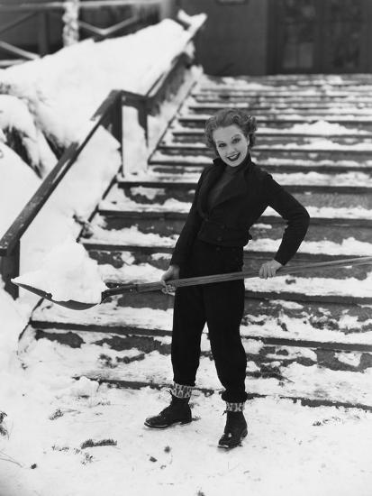 Portrait of Woman Shoveling Snow--Photo