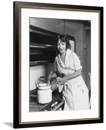 Portrait of Woman Stirring Pot on Stove--Framed Photo