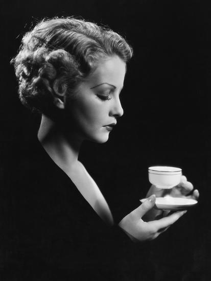 Portrait of Woman with Beverage--Photo
