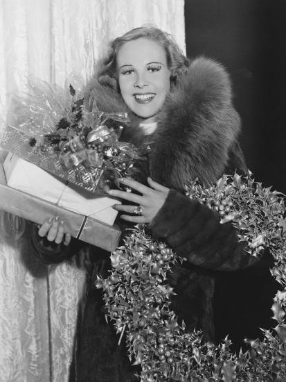 Portrait of Woman with Christmas Wreath and Gifts--Photo