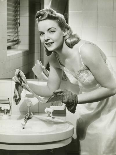 Portrait of Young Woman Cleaning Stockings in Bathroom-George Marks-Photographic Print