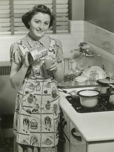 Portrait of Young Woman in Kitchen Holding Can of Soup-George Marks-Photographic Print