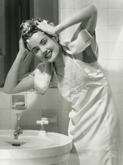 Portrait of Young Woman Washing Hair in Bathroom-George Marks-Photographic Print