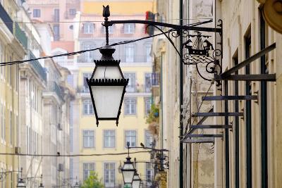 Portugal, Lisbon. Wrought Iron Street Lights on Corner of Building. Maritime Emblem-Emily Wilson-Photographic Print