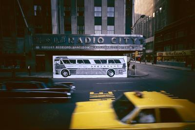Poster of a Greyhound Bus in Front of Radio City Music Hall, New York, New York, Summer 1967-Yale Joel-Photographic Print