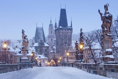 Prague - Charles Bridge Tower Nad St. Nicolas Church on Winter Morning