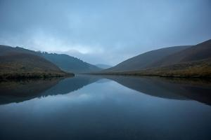 A Still River Reflects Mountains by Prasenjeet Yadav