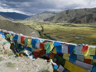 https://imgc.artprintimages.com/img/print/prayer-flags-and-view-over-cultivated-fields-yumbulagung-castle-tibet-china_u-l-p1e6st0.jpg?p=0